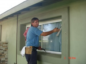 window washer demonstrating window washing technique in Phoenix